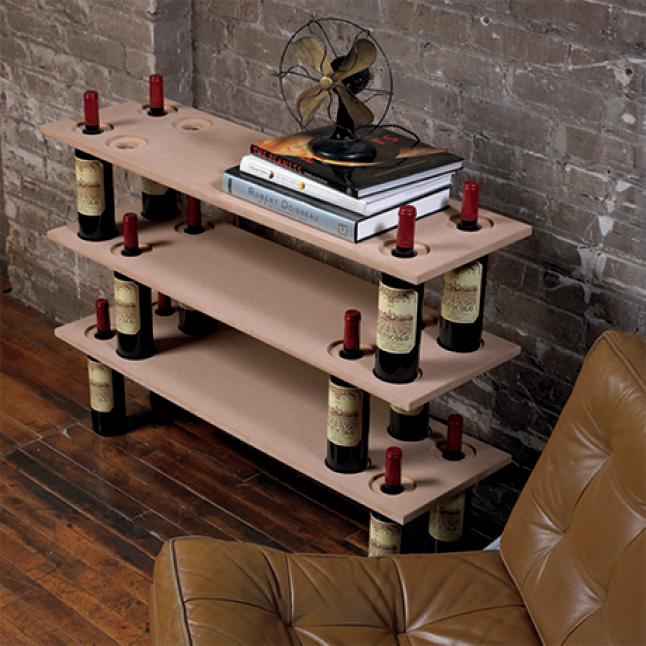 Unique shelving made from MDF project panels supported by wine bottles