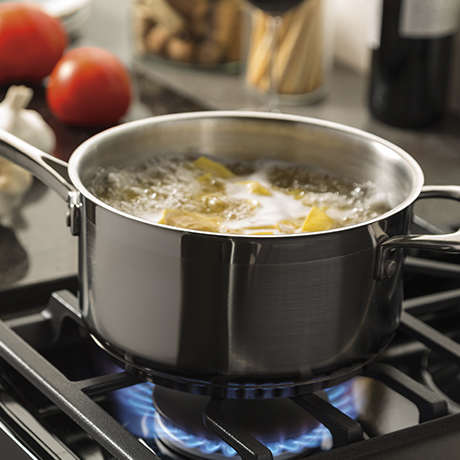 An intense gas burner creates high heat to boil water quickly.