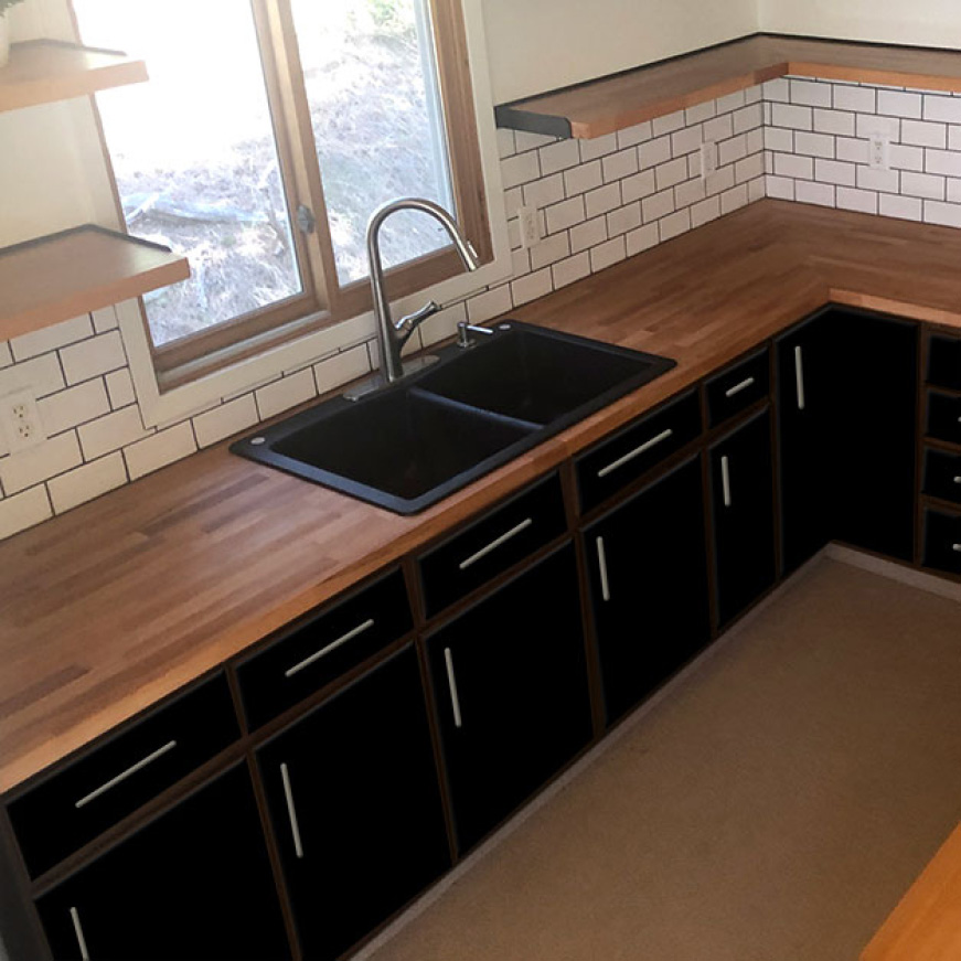 Hardwood Reflections Unfinished Beech Butcher Block Countertop Installed in a Kitchen