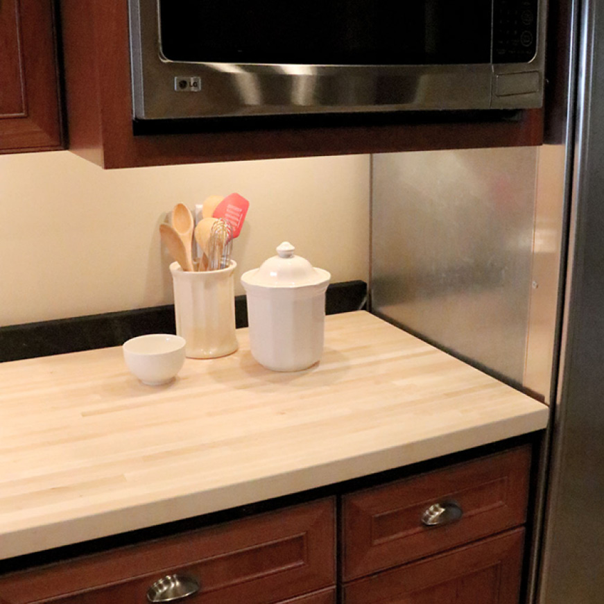 Hardwood Reflections Unfinished Maple Butcher Block Countertop Installed in a Kitchen
