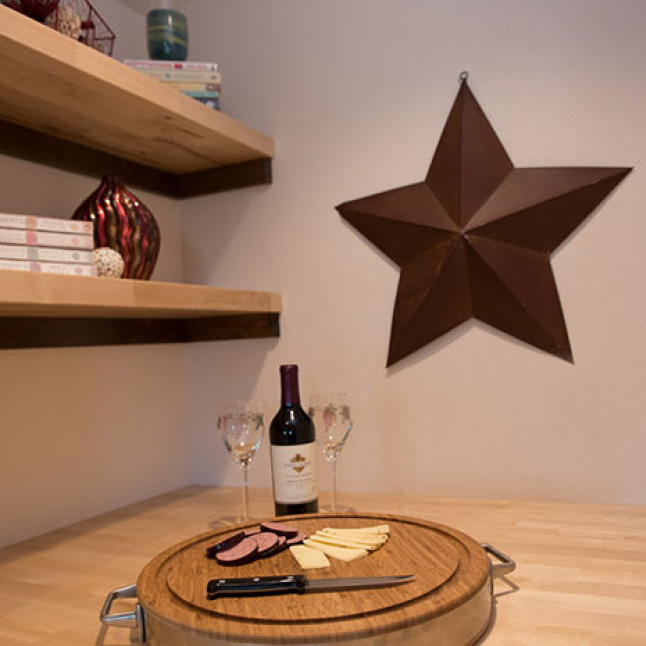 Dress up a wall by adding Hardwood Reflections Birch Butcher Block as open shelving.