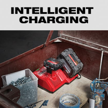 M18 REDLITHIUM battery charging on a Milwaukee dual voltage charger in tool storage chest.