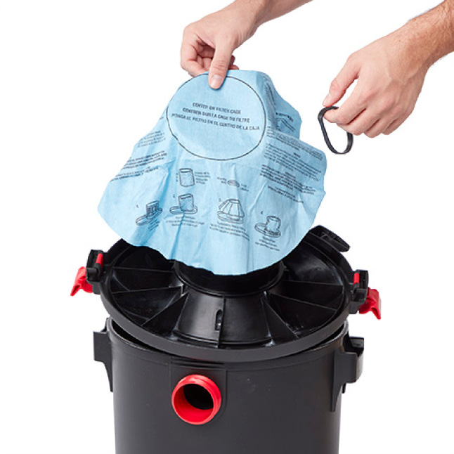 Detach the lid and place the motor upside down in the drum. Locate the filter cage. Drape filter on top.