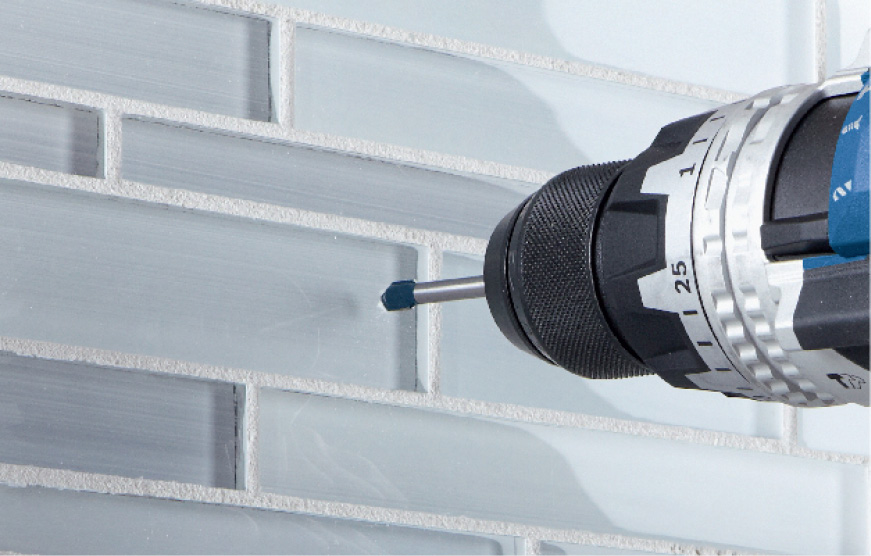 Bosch Glass and Tile bit drilling into glass subway tile