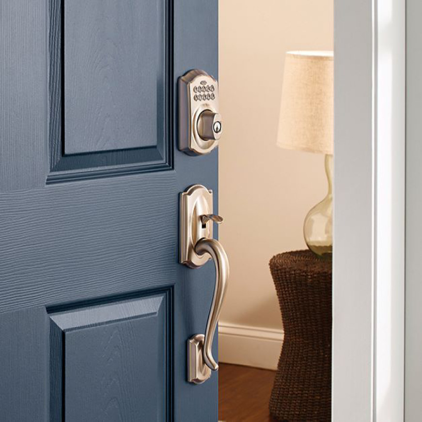 Schlage Camelot satin nickel keypad deadbolt with Camelot grip on blue front door.