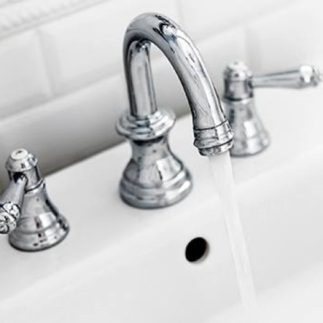 Clean bathroom sink free of soap scum with Mr. Clean