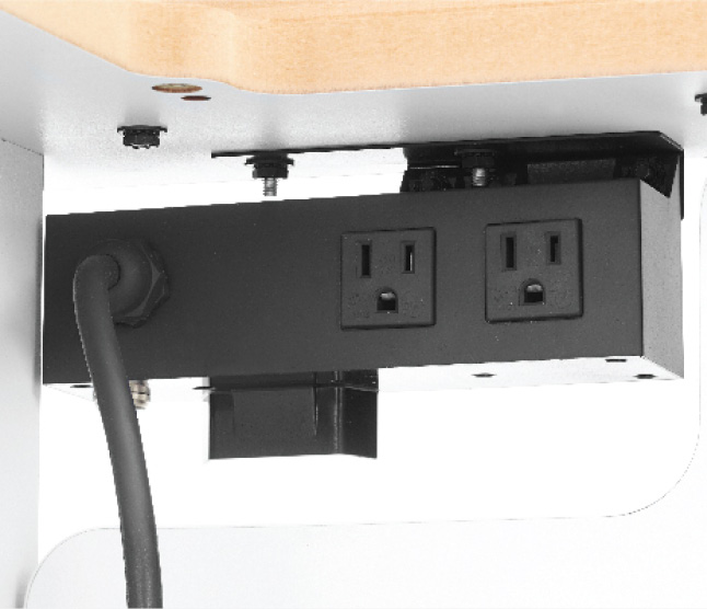Close up of two outlets on back of router table