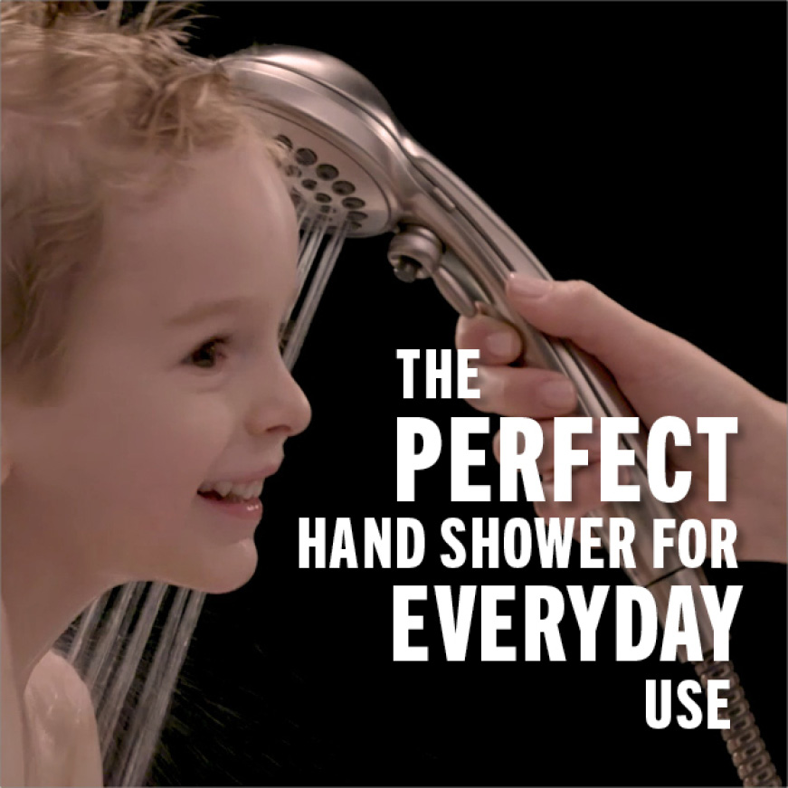 Image is an up-close image of a small child being bathed with the versatile hand shower.