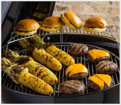 Use the warming rack to keep food warm while food grills below