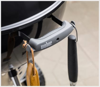 Hang your grilling tools on the hooks for easy access.