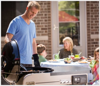 Slide the lid over to the side of the grill, and tuck it away.