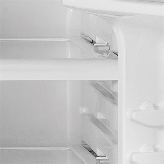 Close up of shelf inside refrigerator