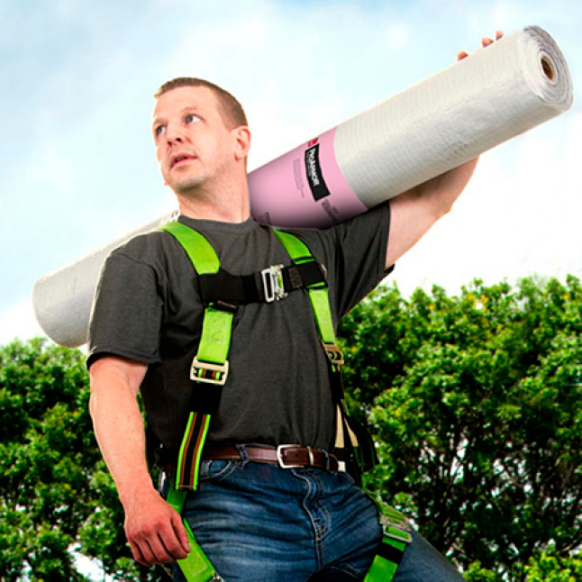 Man Carrying roll of ProArmor Synthetic Underlayment