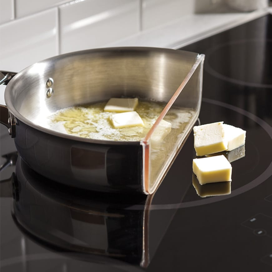 Butter melts in an induction pan, but not on the burner