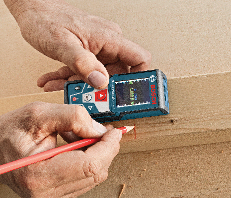 Bosch GLM 50 CX being used to mark measurements on wood.