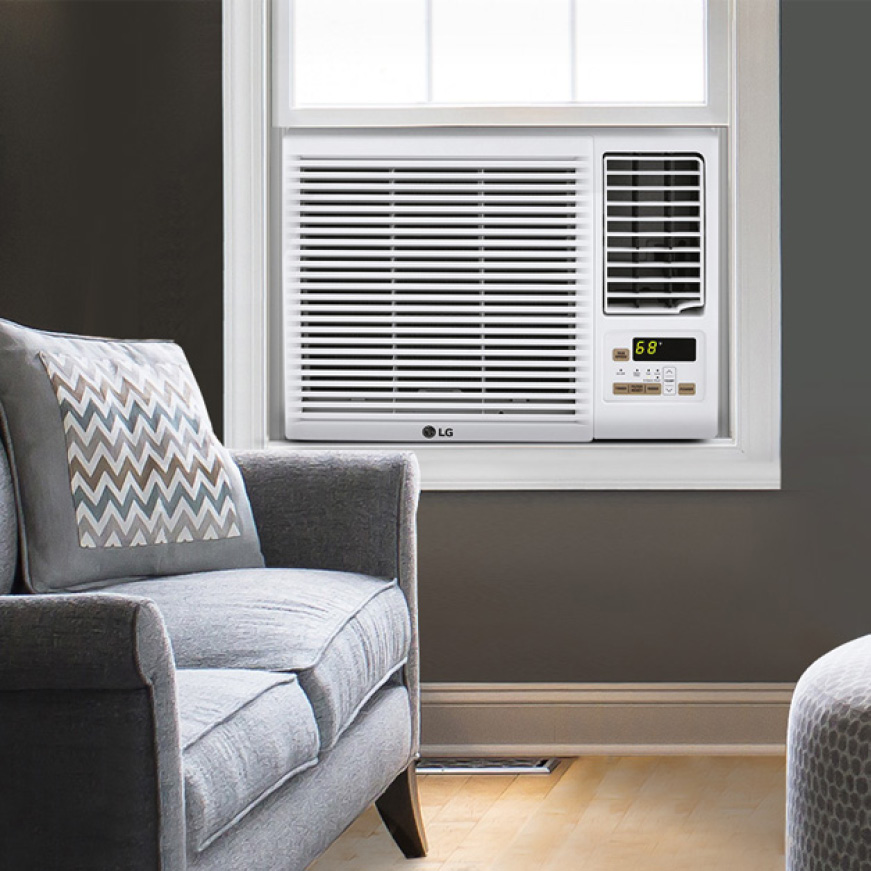 Window air conditioner in room with a sofa