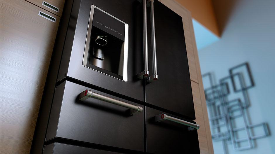 Upward angled shot of the refrigerator set in a modern kitchen.