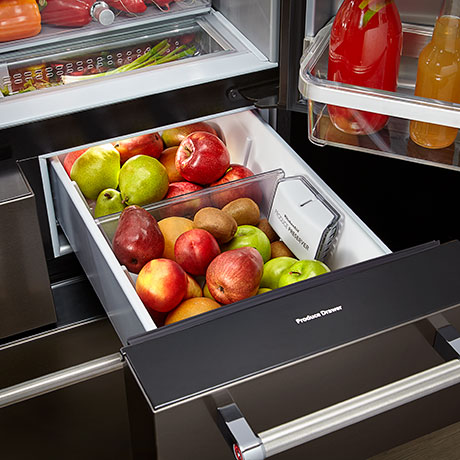 External refrigerator drawer, fully open, stocked with apples and pears.
