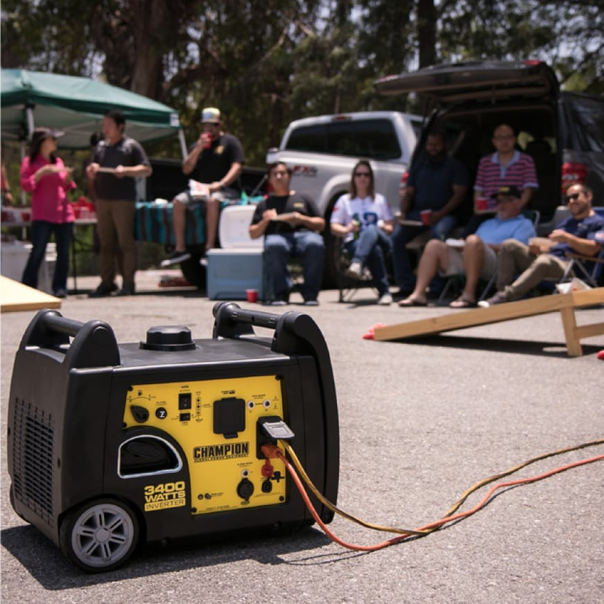 Lifestyle image of inverter generator powering a tailgate party