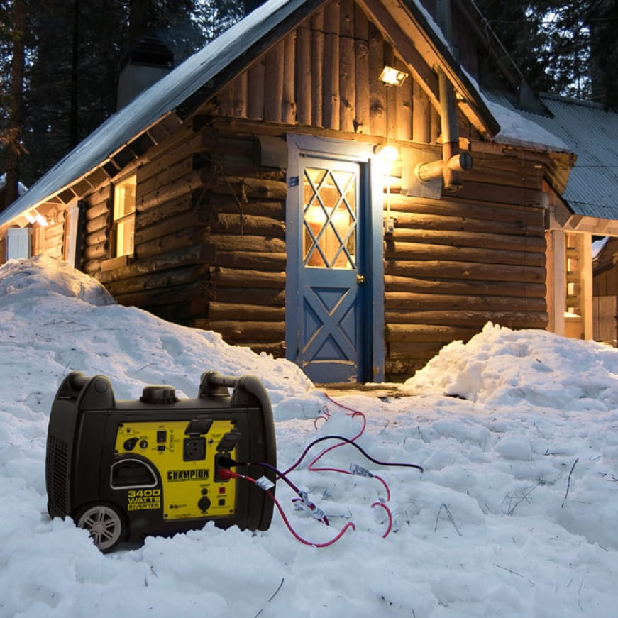 Lifestyle image of inverter generator powering a cabin in snow