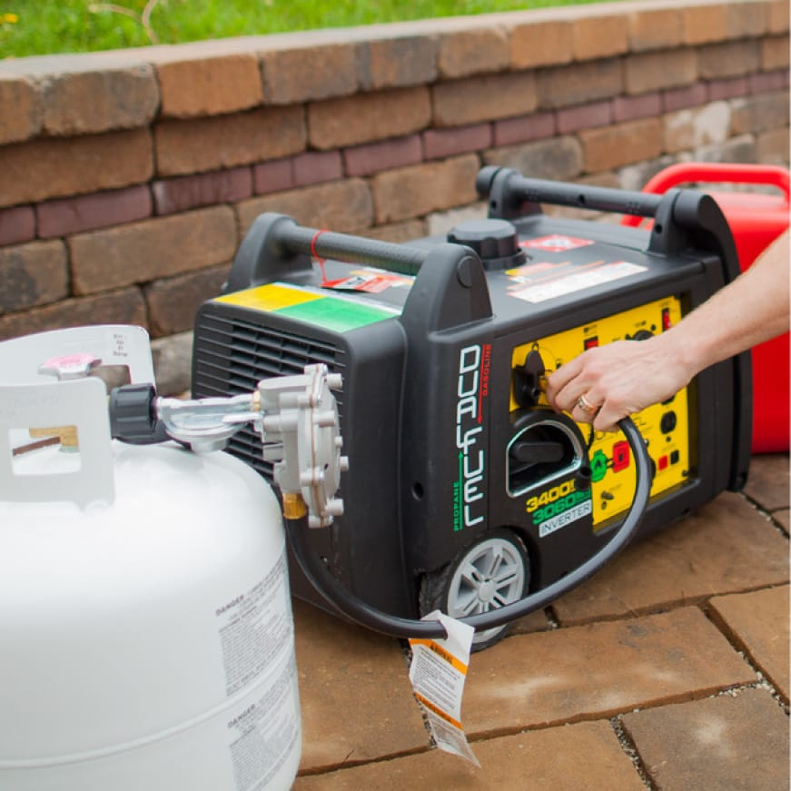 Lifestyle image of generator hooked up to a 20 lb. propane tank