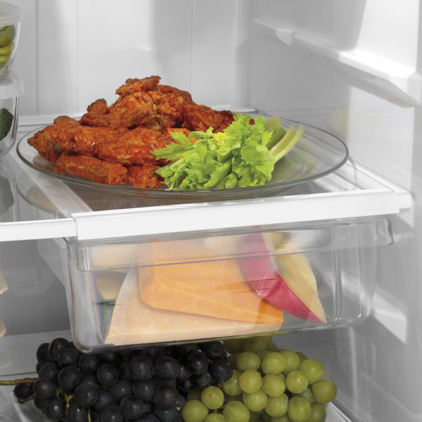 GE Appliances, the best bottom freezer refridgerator for food organizing. The snack drawer holds a variety of cheeses.