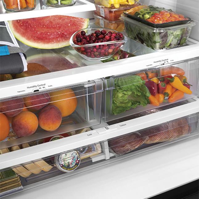 A variety of fresh fruits, vegetables, meats and cheeses are held inside the fridge's drawers, each with its own humidity and temperature controls.