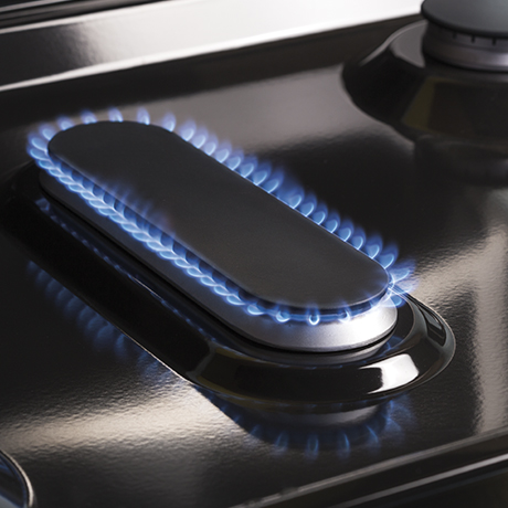 A large oval fifth burner on the gas cooktop is ideal for evenly heating a griddle.