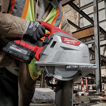 """Man wearing a hi-vis vest and work gloves uses the M18 FUEL 8"""" Metal Cutting Circular Saw on corrugated decking"""