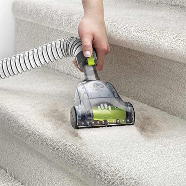Air Steerable Vacuum Cleaner Pet Turbo Tool in use on staircase.
