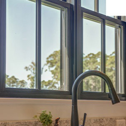 Interior bronze window frame that matches kitchen hardware bronze color for a uniform look