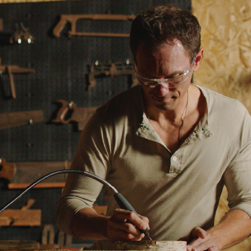 Image of man engraving with a rotary tool