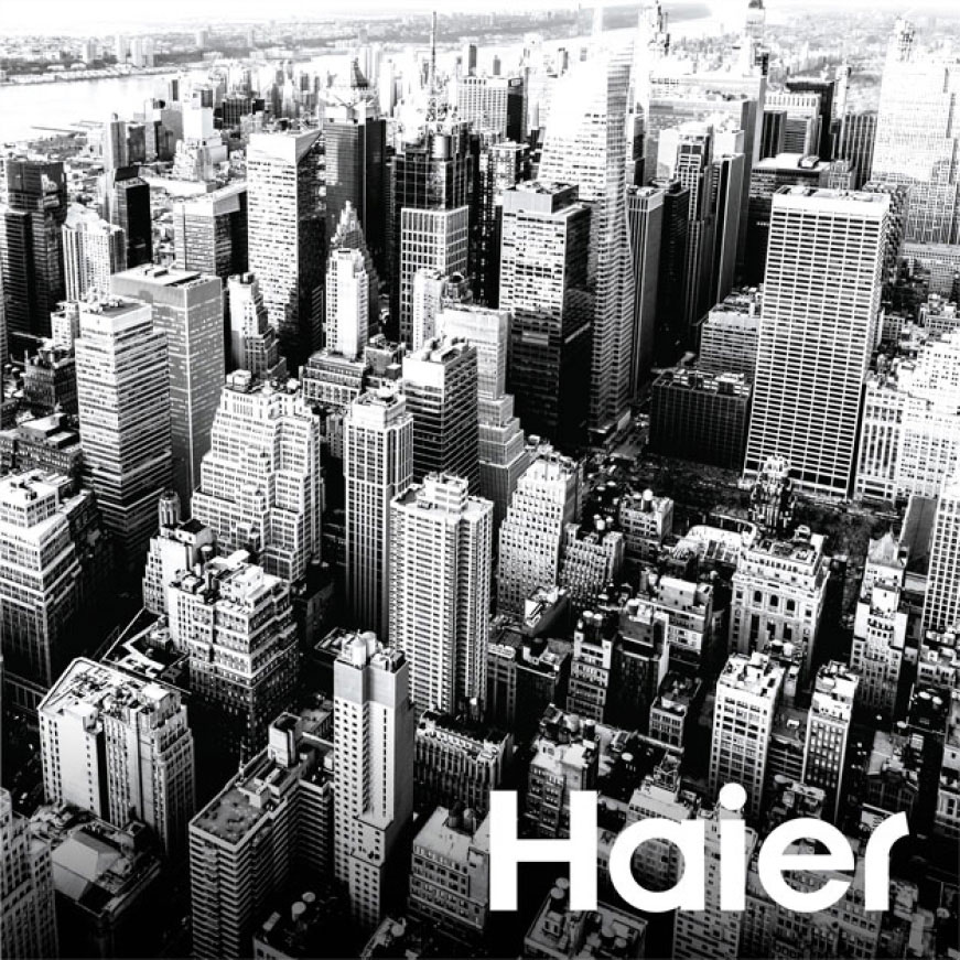 Black and white image of a cityscape. Haier over the range microwaves are perfect for those living in small spaces in the city.