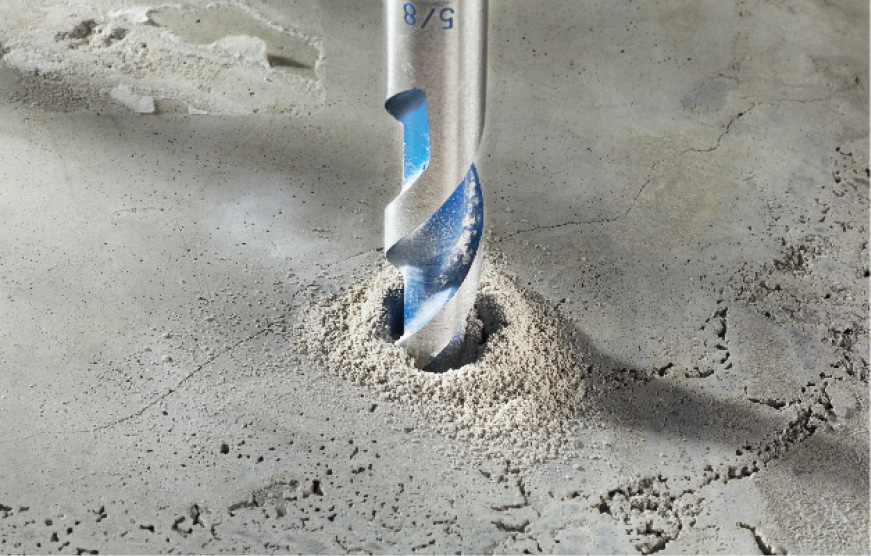 Bosch BlueGranite Turbo bit drilling into concrete.