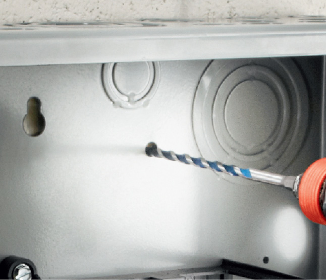 Bosch BlueGranite Turbo bit drilling into electric box