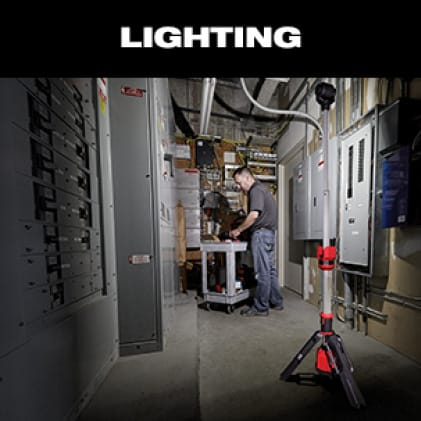 Electrician uses M12 ROCKET Tower Light on a service call.
