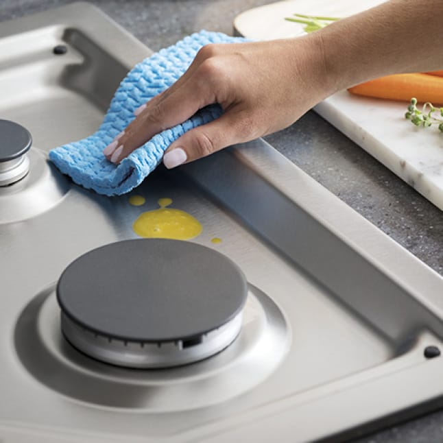 A spill is contained inside the recessed burner