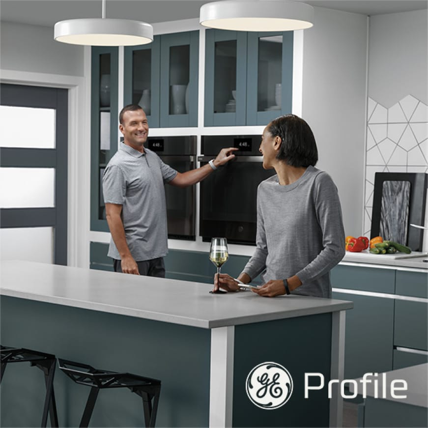 Image of man and woman interacting in kitchen