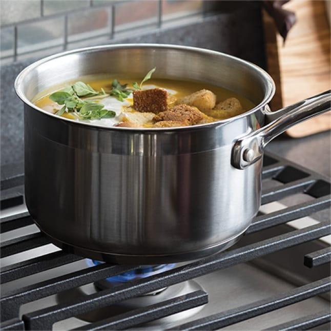 Image of sauce simmering on cooktop burner