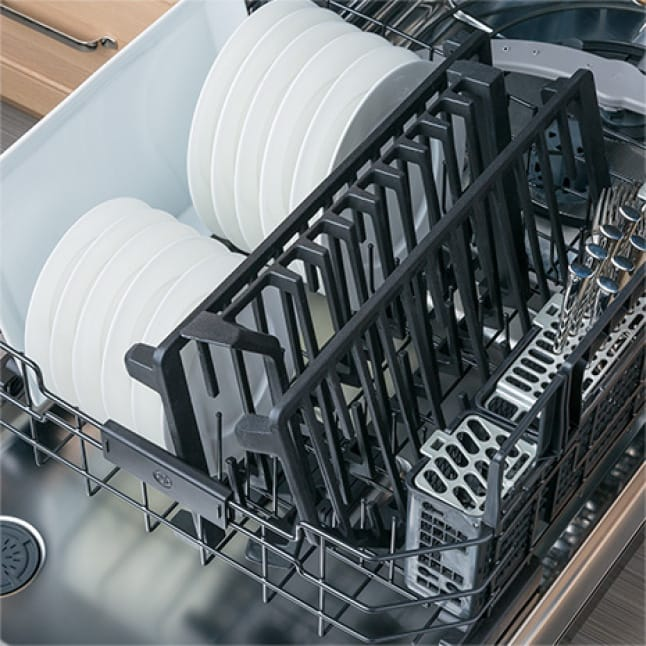 Image of dishwasher door open with bottom rack loaded with dishes and cooktop grates