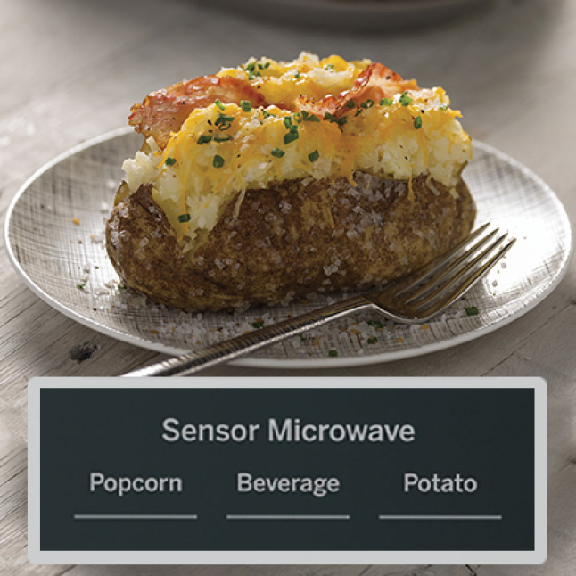 A fully-dressed baked potato sits on a plate next to a fork. A square overlay shows the three sensor microwave buttons: popcorn, beverage and potato.
