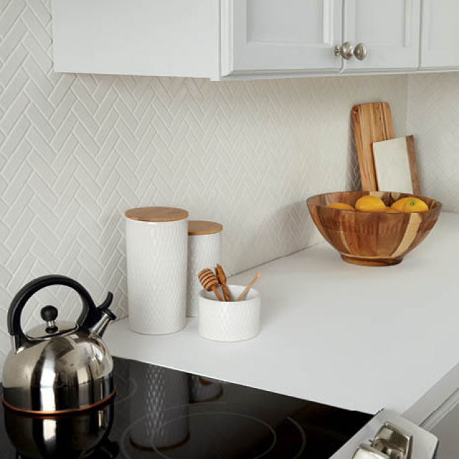 Kitchen backsplash featuring the herringbone mosaic