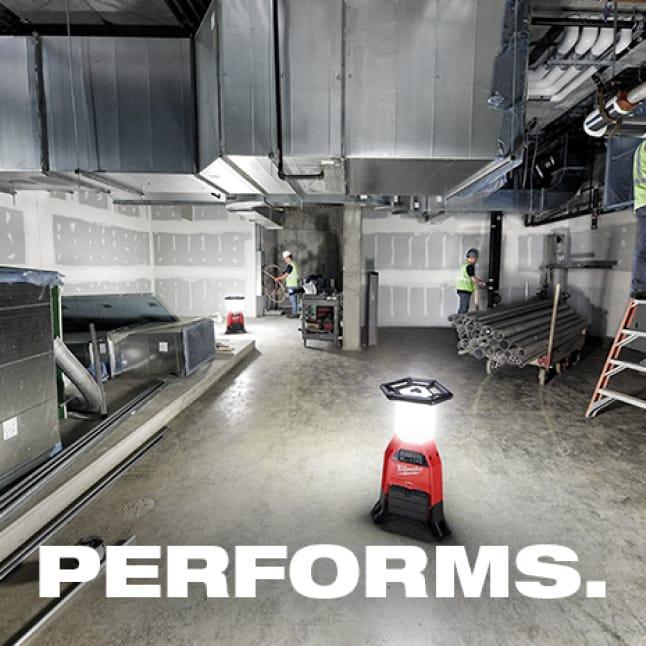 Milwaukee RADIUS site lights light up an industrial jobsite.