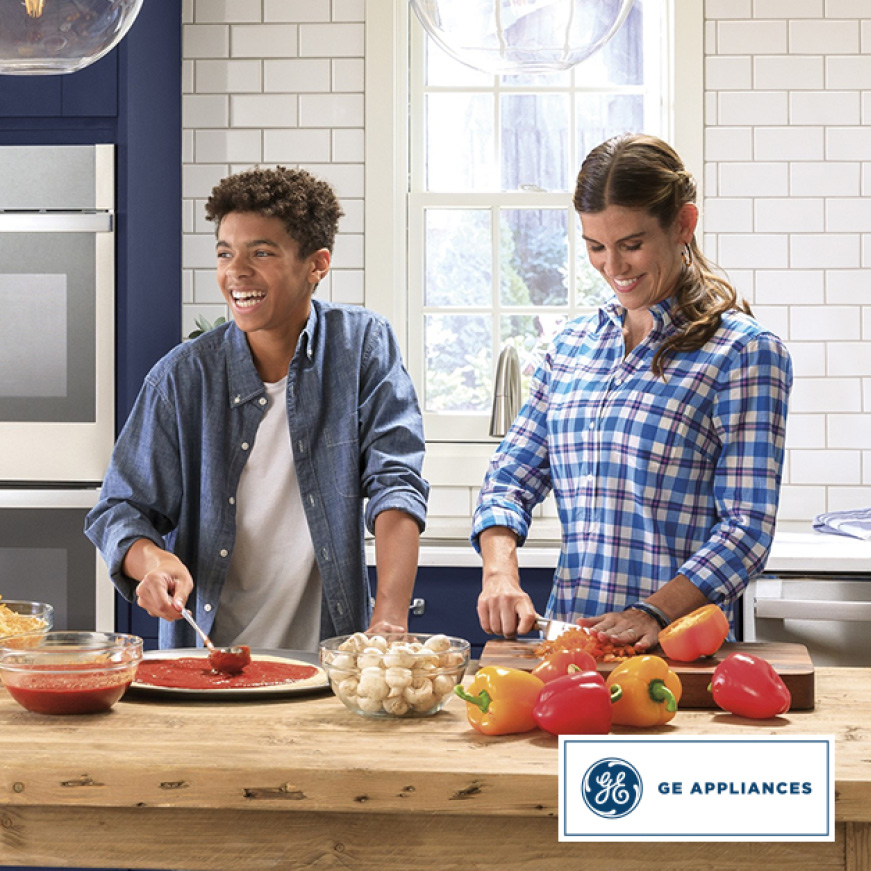 A mother and her prepping dinner with a GE Appliances logo