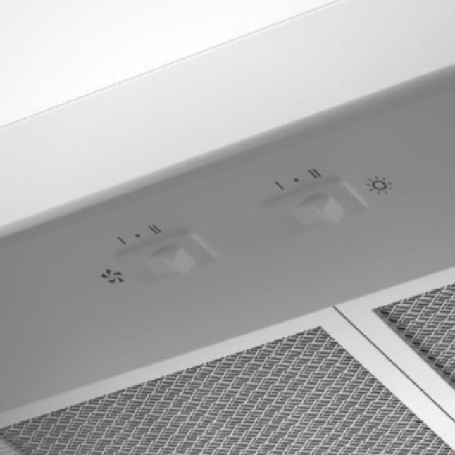 Zoomed in image of the view of the white rocker switches on just under the front of the white range hood.