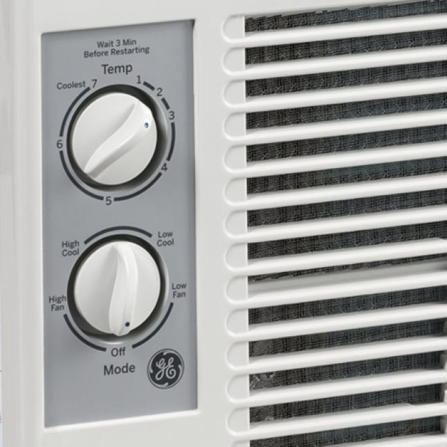 A closeup of the knobs on the air conditioner