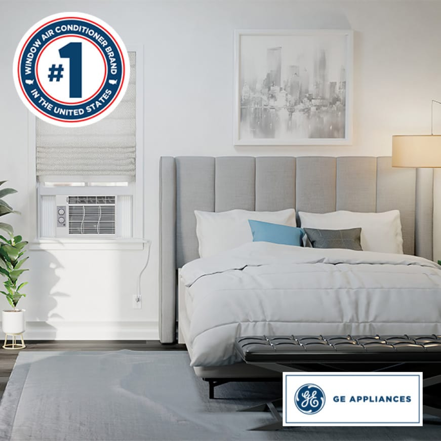 A conservative but modern bedroom has been equipped with a window air conditioner.