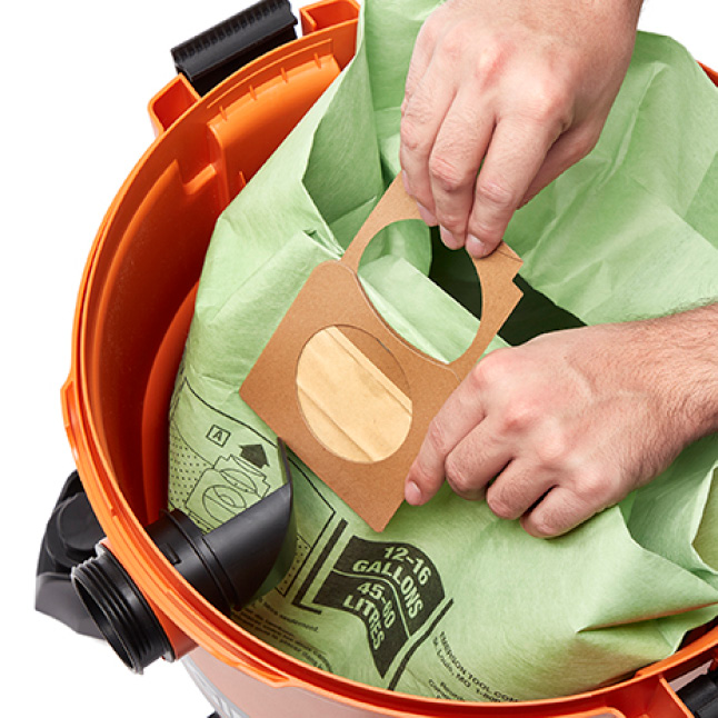 Pull up on cardboard to fully seal debris inside bag without any overspill.