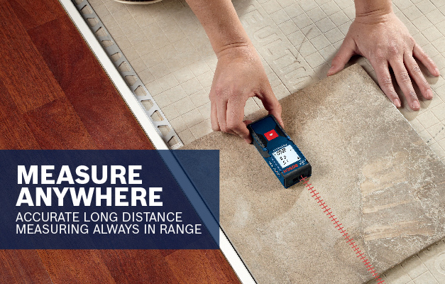 Bosch GLM165-10 projecting straight line on floor to measure for tiling installation.