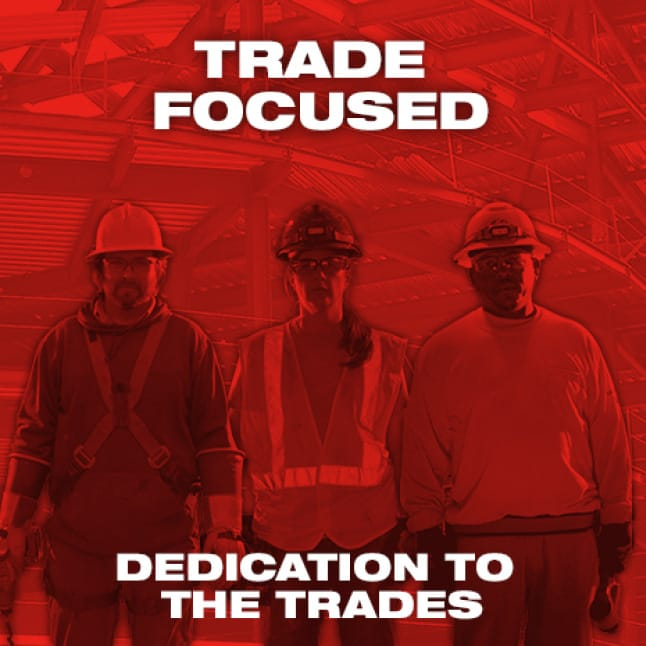 Three trade professionals in safety gear on red background